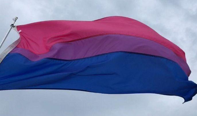 bi pride flag flying at Gunnison Beach