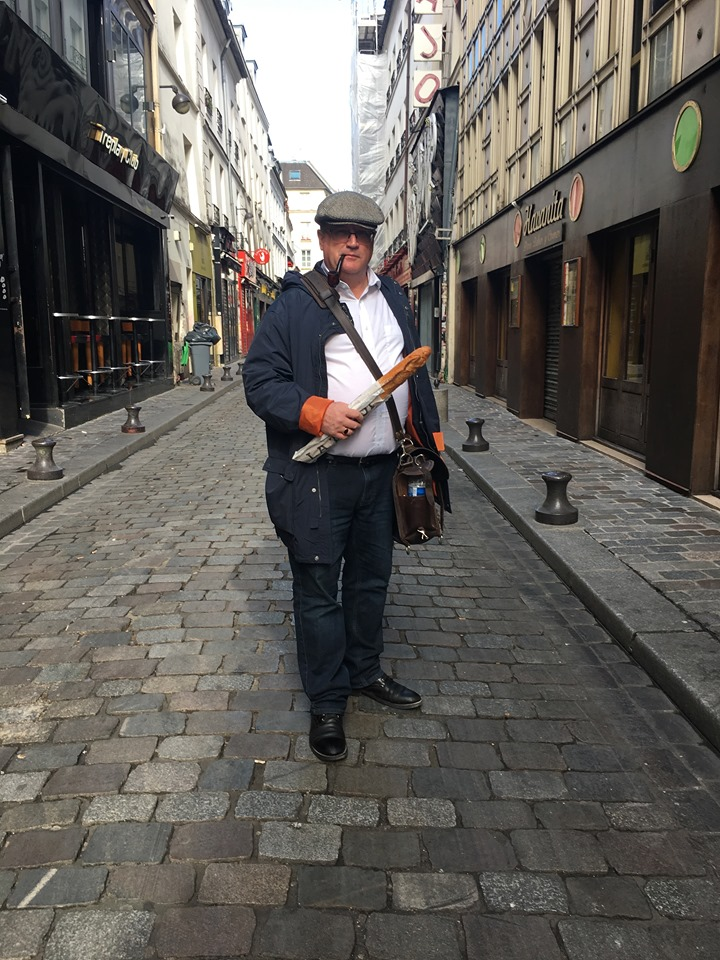 Bill Lutz with a baguette in Paris