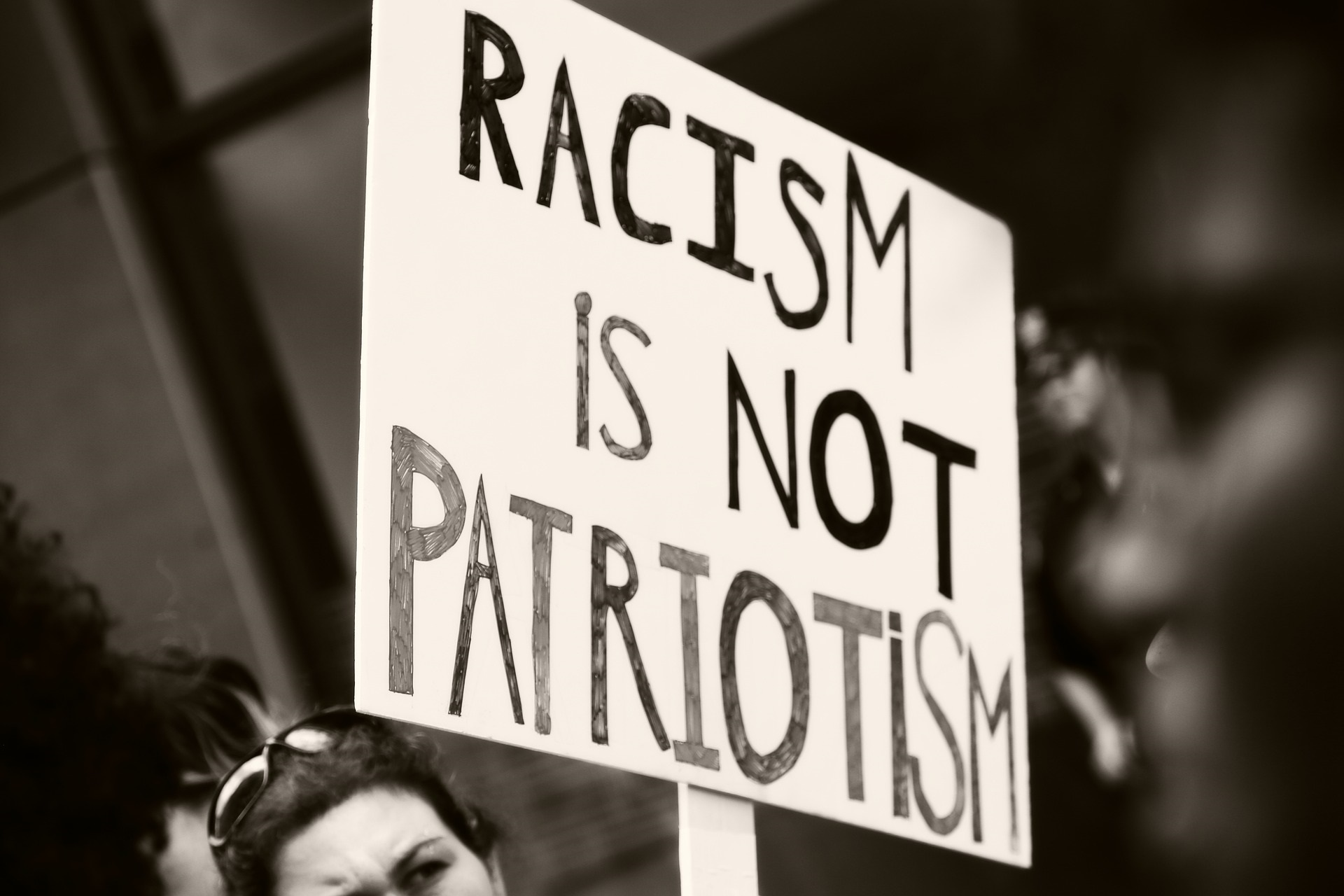 Racism is not Patriotism protest sign