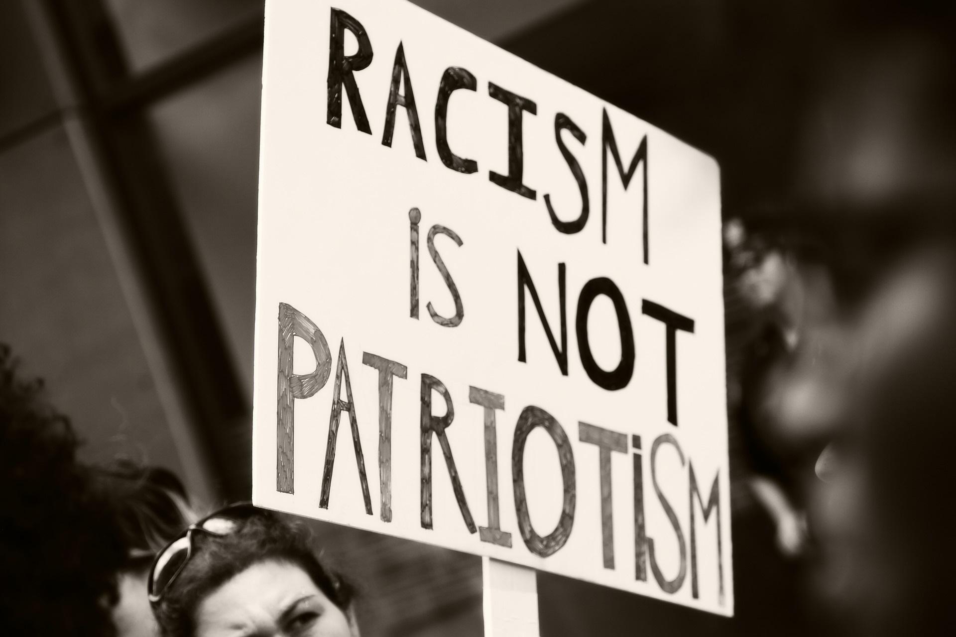 Racism is not Patriotism protest sign