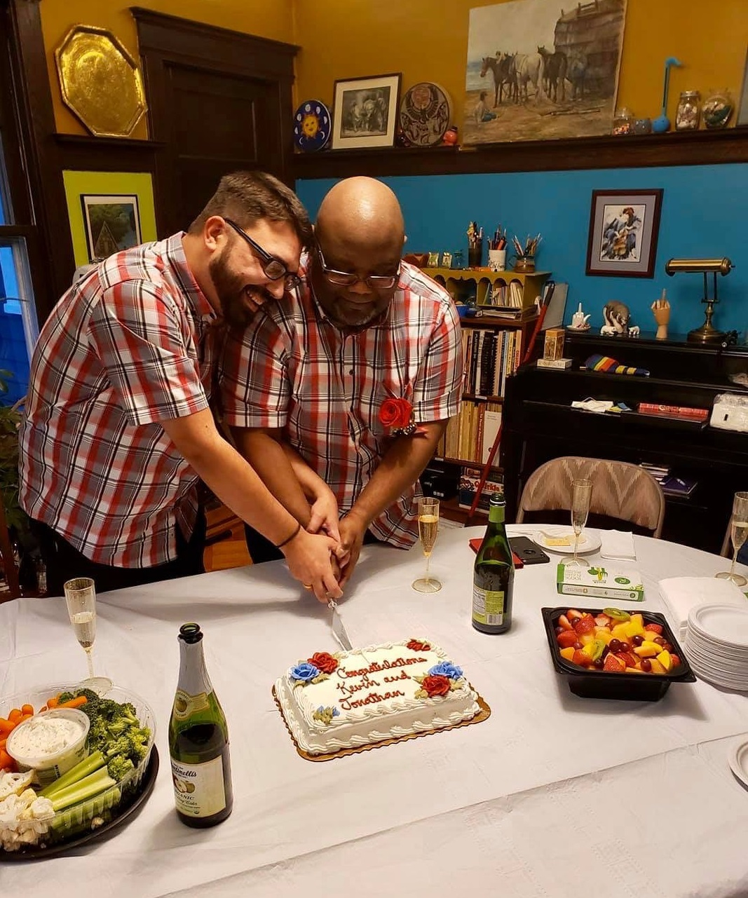 Jonathan & Kevin King, cutting the wedding cake 12/1/19