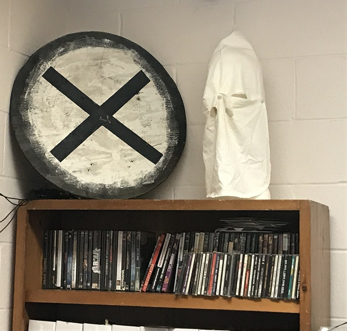 shield and Klan hood in the One People's Project office