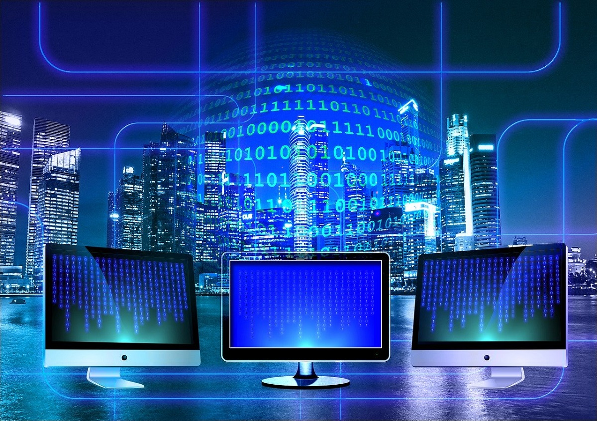 binary code on blue computer monitors, globe, and city