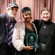 Robin Renée wins 2019 Brenda Howard Award (standing with Larry Nelson and Estraven)