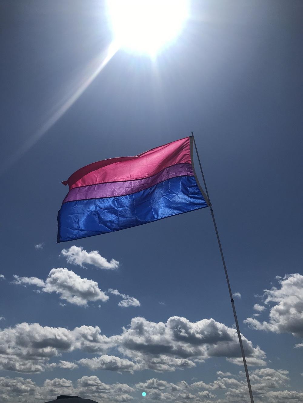 bi pride flag flying at Gunnison beach, August 2019. Photo by Robin Renée