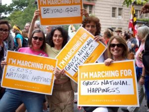 Ginny Sassaman and friends promote Gross National Happiness at a climate march