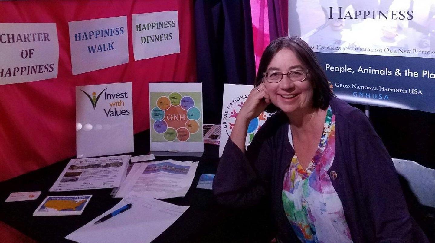 Ginny Sassaman representing Gross National Happiness