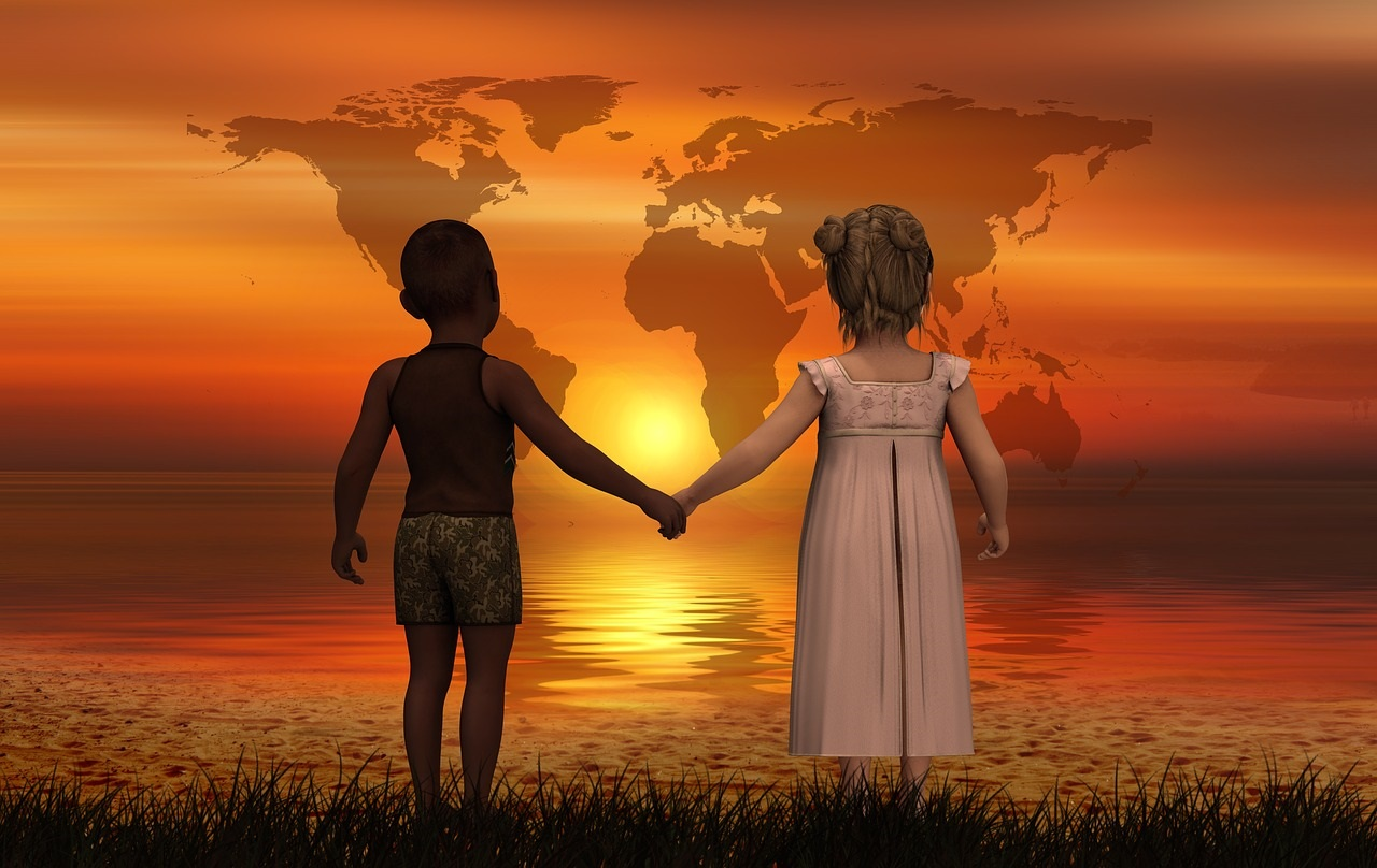 children holding hands in the sunset, looking out at the horizon and map of the world